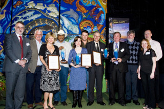 Kandy Curran & Kevin Puertellano accept a WA Regional Achievement Community Awards for RBWG.